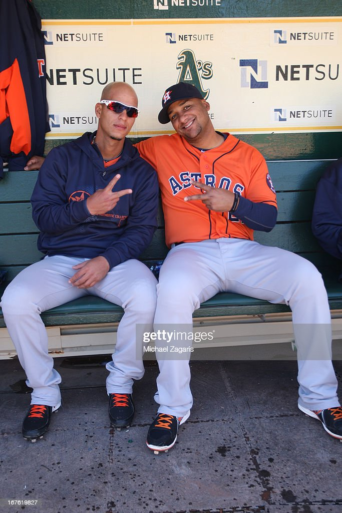 Ronny Cedeno and Carlos Corporan of the Houston Astros relax in the dugout prior to the game against the Oakland Athletics at Oco Coliseum on April...