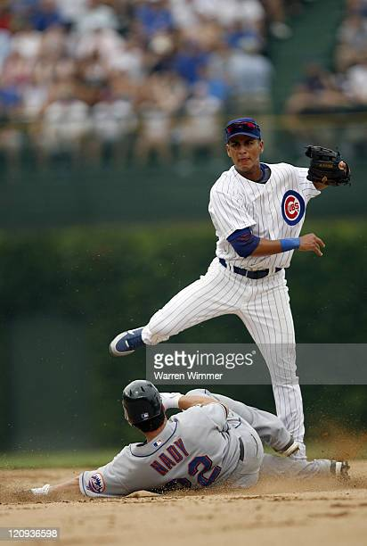 Ronny Cedeno Chicago Cub shortstop avoids a sliding Xavier Nady at Wrigley Field in Chicago Illinois on July 14 2006 The New York Mets over the...