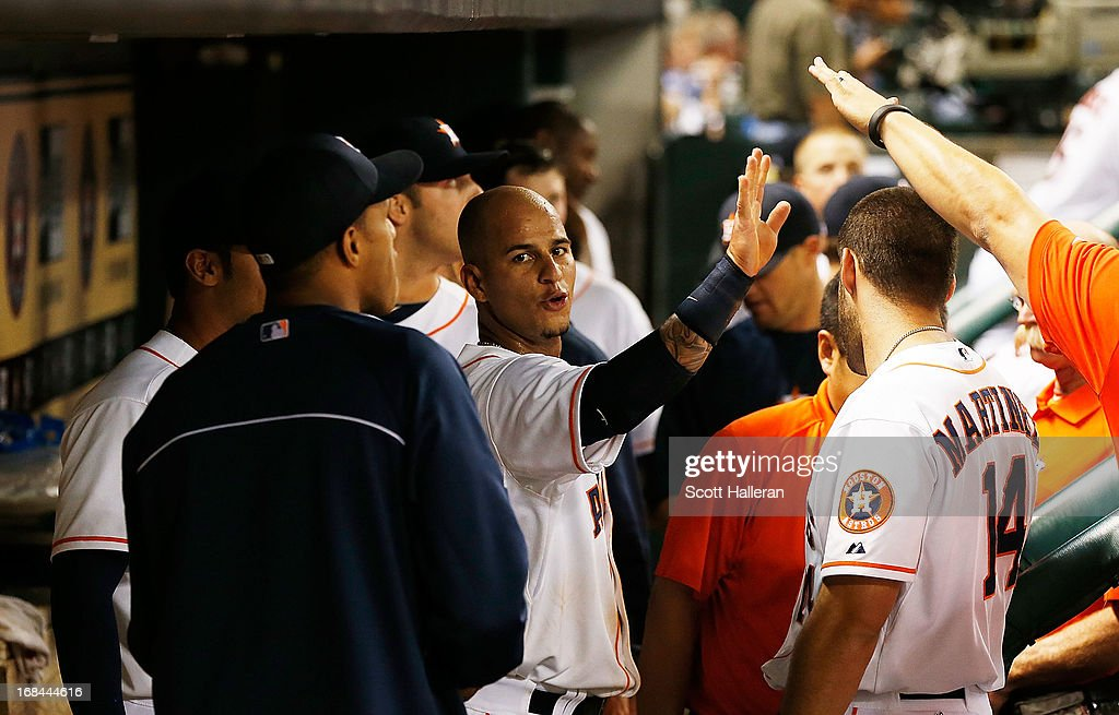 Ronny Cedeno of the Houston Astros celebrates with his teammates after scoring a run in the fifth inning against the Los Angeles Angels of Anaheim at...