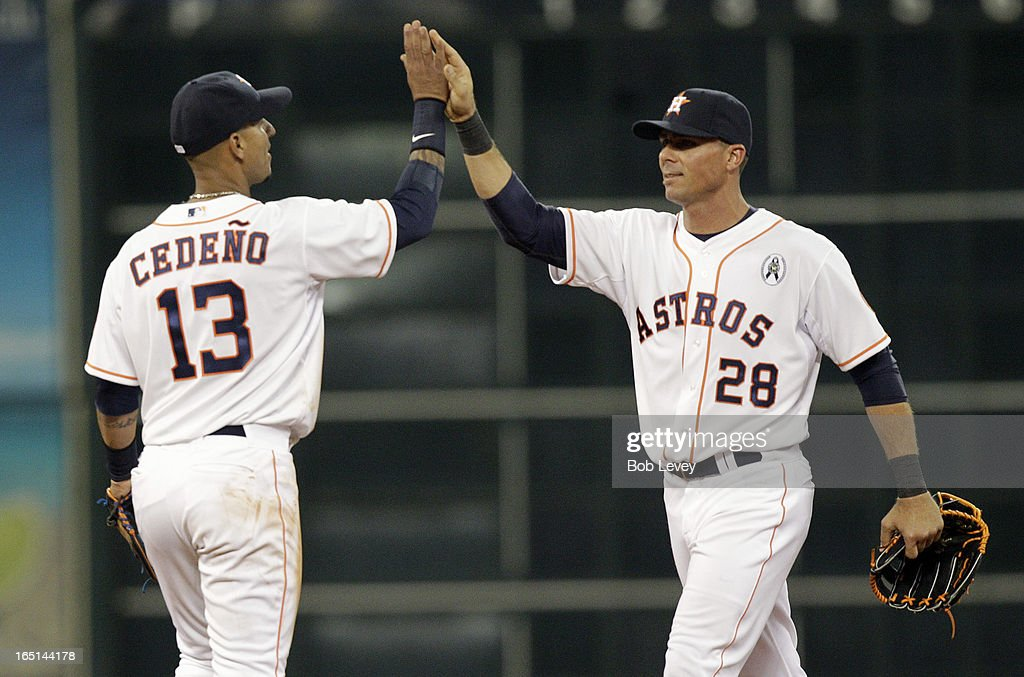 <a gi-track='captionPersonalityLinkClicked' href=/galleries/search?phrase=Ronny+Cedeno&family=editorial&specificpeople=546778 ng-click='$event.stopPropagation()'>Ronny Cedeno</a> #13 of the Houston Astros high fives <a gi-track='captionPersonalityLinkClicked' href=/galleries/search?phrase=Rick+Ankiel&family=editorial&specificpeople=803371 ng-click='$event.stopPropagation()'>Rick Ankiel</a> #28 of the Houston Astros after the final out against the Texas Rangers at Minute Maid Park on March 31, 2013 in Houston, Texas.