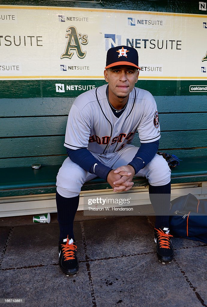 Ronny Cedeno of the Houston Astros looks on from the dugout before the start of his MLB baseball game against the Oakland Athletics at Oco Coliseum...