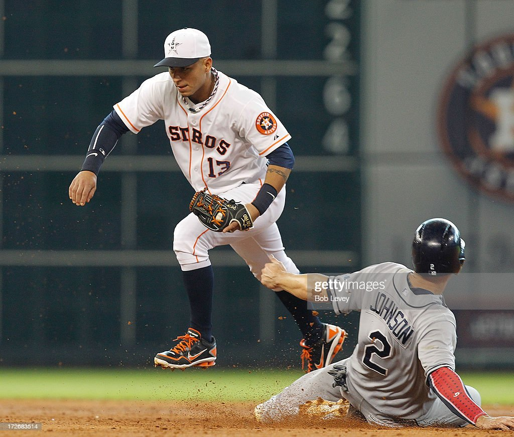 Ronny Cedeno of the Houston Astros steps on second base to force out Kelly Johnson of the Tampa Bay Rays at Minute Maid Park on July 4 2013 in...