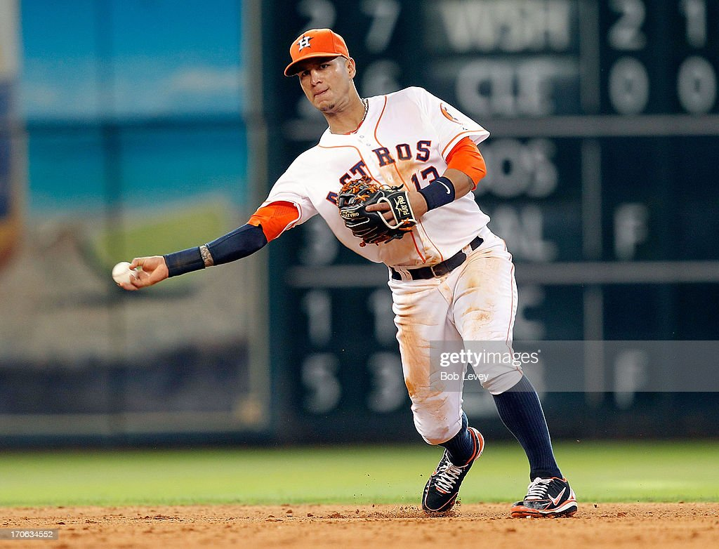 Ronny Cedeno of the Houston Astros throws out Alejandro De Aza of the Chicago White Sox at Minute Maid Park on June 15 2013 in Houston Texas