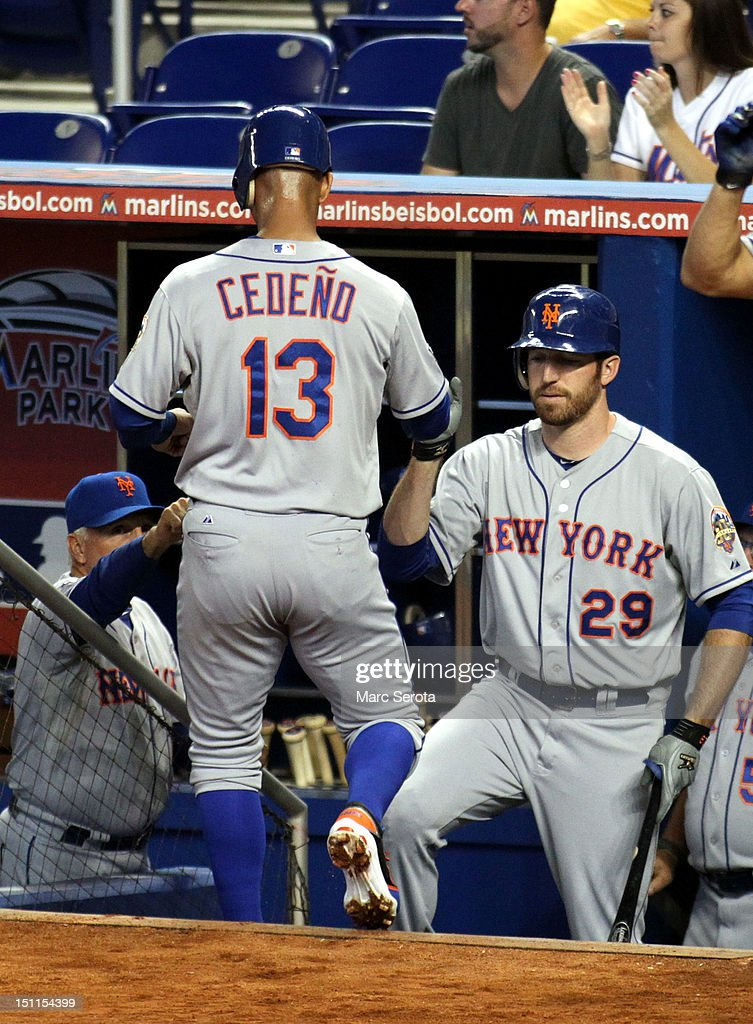 Ronny Cedeno of the New York Mets celebrates scoring a run with teammate Ike davis against the Miami Marlins at Marlins Park on September 2 2012 in...