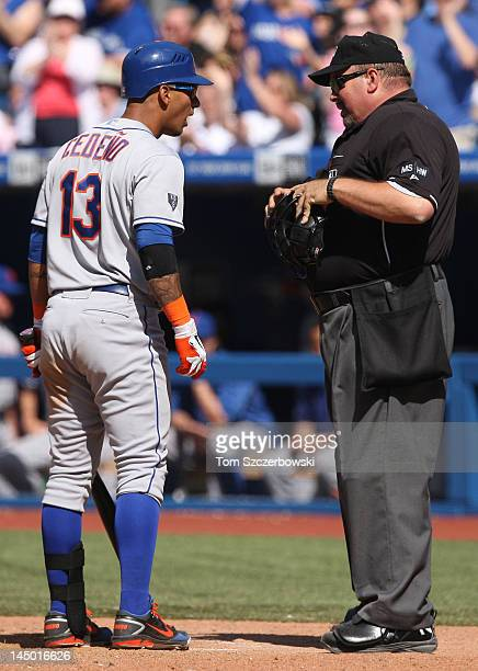Ronny Cedeno of the New York Mets questions home plate umpire Wally Bell after striking out in the 9th inning during MLB game action against the...