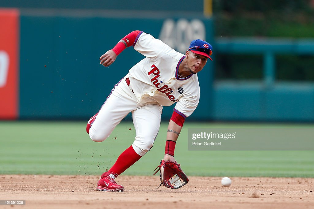 <a gi-track='captionPersonalityLinkClicked' href=/galleries/search?phrase=Ronny+Cedeno&family=editorial&specificpeople=546778 ng-click='$event.stopPropagation()'>Ronny Cedeno</a> #7 of the Philadelphia Phillies fields a ground ball in the sixth inning of the first game of a doubleheader against the Atlanta Braves at Citizens Bank Park on June 28, 2014 in Philadelphia, Pennsylvania.