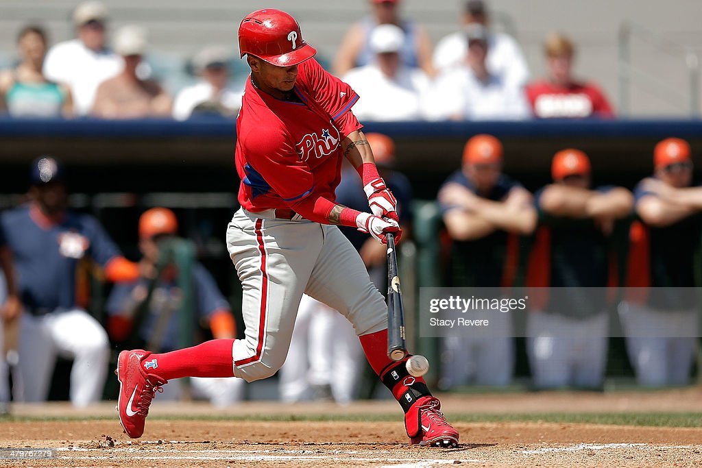 Ronny Cedeno of the Philadelphia Phillies swings at a pitch in the first inning of a game against the Houston Astros at Osceola County Stadium on...