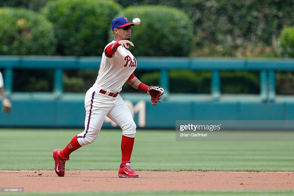 Ronny Cedeno of the Philadelphia Phillies throws the ball to first in the first inning of the first game of a doubleheader against the Atlanta Braves...
