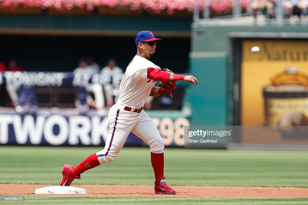 Ronny Cedeno of the Philadelphia Phillies turns a double play during the first game of a doubleheader against the Atlanta Braves at Citizens Bank...
