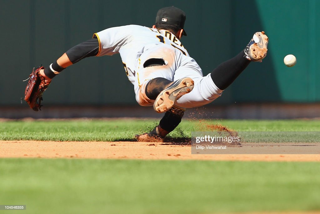 Ronny Cedeno of the Pittsburgh Pirates attempts to field a ground ball against the St Louis Cardinals at Busch Stadium on September 29 2010 in St...