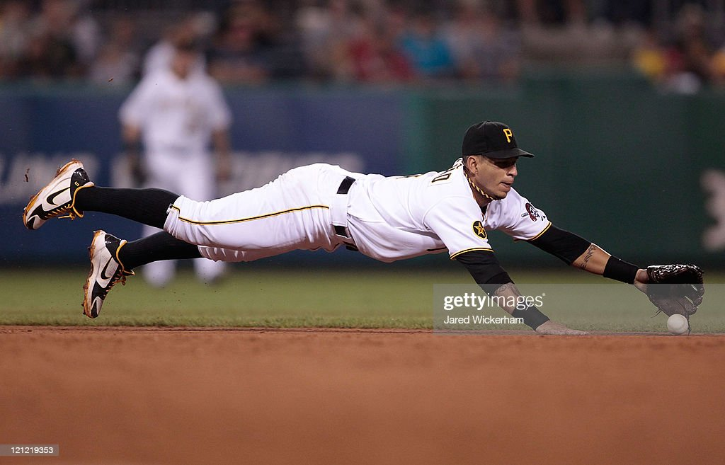 Ronny Cedeno of the Pittsburgh Pirates dives for a ground ball in the ninth inning against the St Louis Cardinals during the game on August 15 2011...