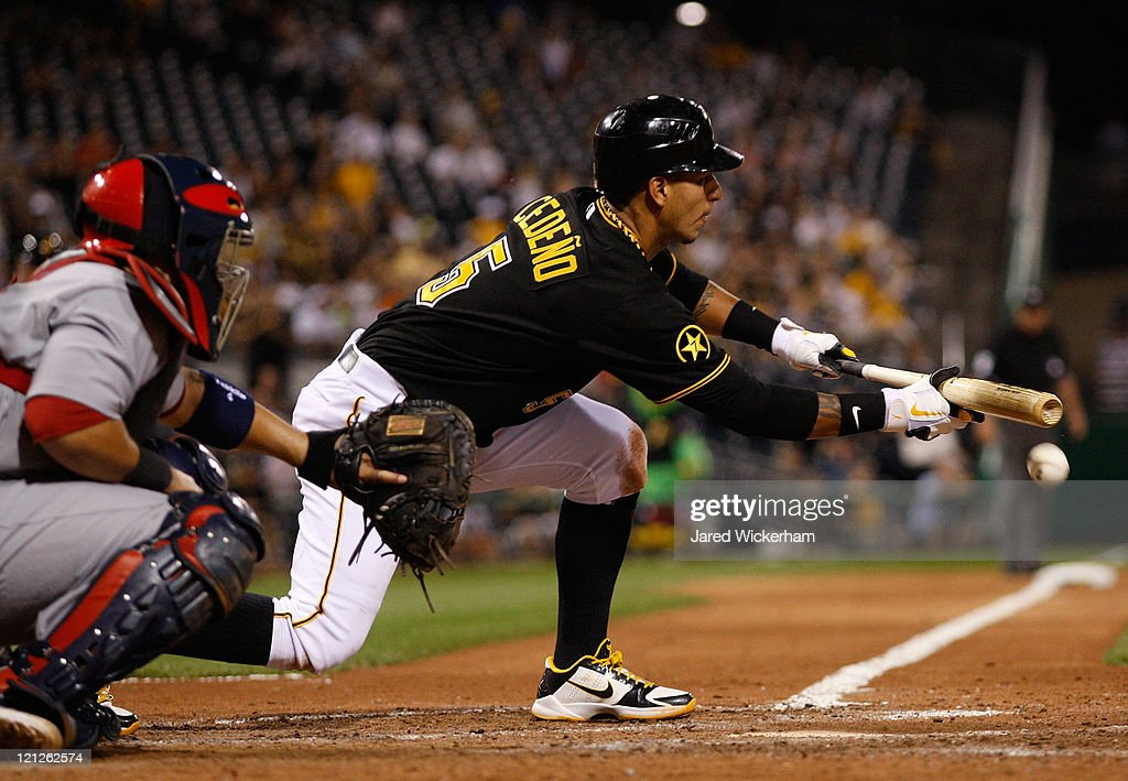Ronny Cedeno of the Pittsburgh Pirates lays down a bunt against the St Louis Cardinals during the game on August 16 2011 at PNC Park in Pittsburgh...