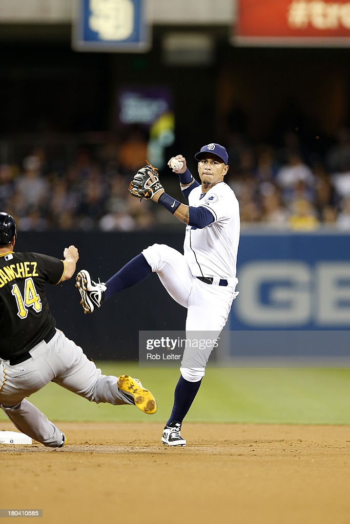 Ronny Cedeno of the San Diego Padres plays shortstop during the game against the Pittsburgh Pirates at Petco Park on August 20 2013 in San Diego...