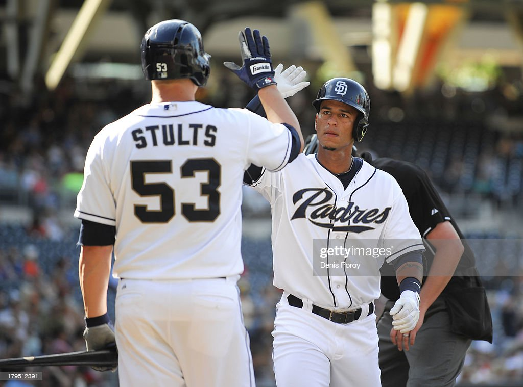Ronny Cedeno of the San Diego Padres right is congratulated by Eric Stults after hitting a solo home run during the second inning of a baseball game...