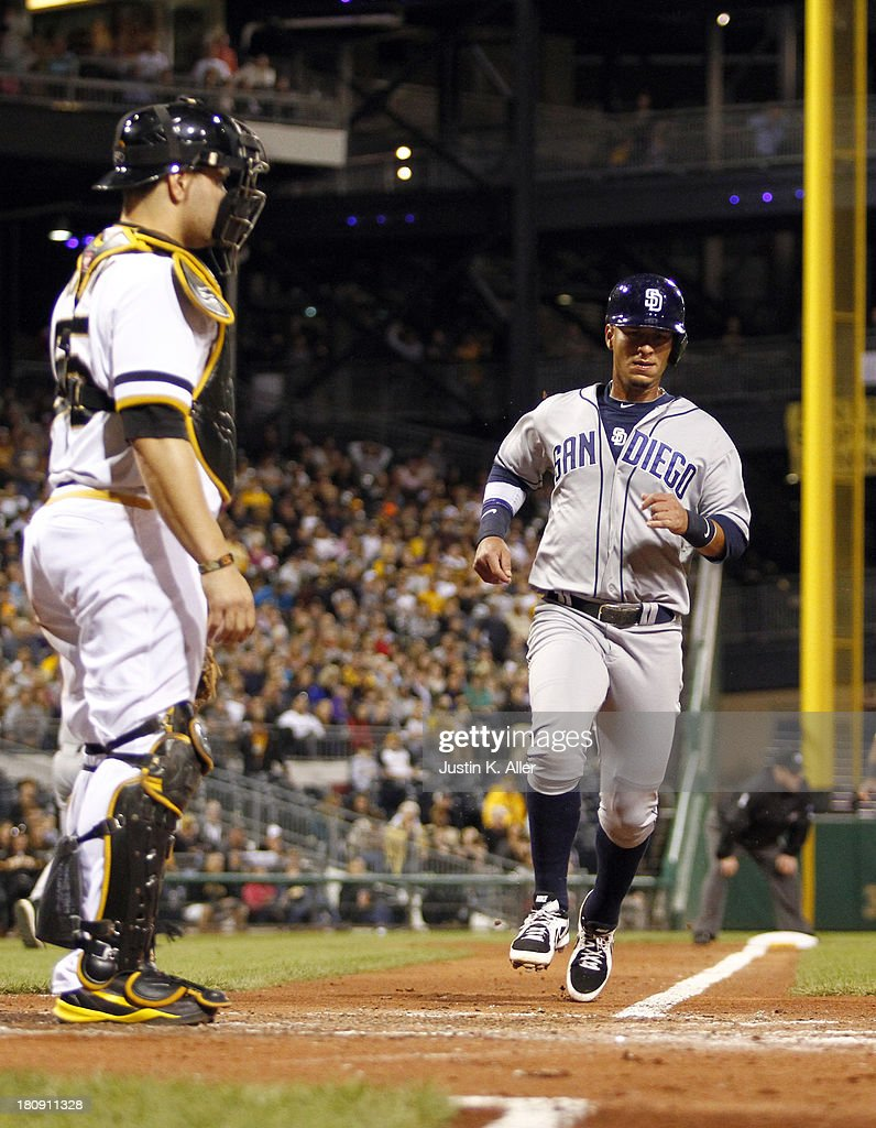 Ronny Cedeno of the San Diego Padres scores in the fourth inning against the Pittsburgh Pirates during the game on September 17 2013 at PNC Park in...