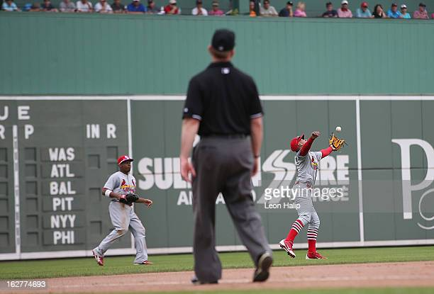 Ronny Cedeno of the St Louis Cardinals makes the catch on the pop out from Jose Iglesias of the Boston Red Sox during the game at JetBlue Park on...