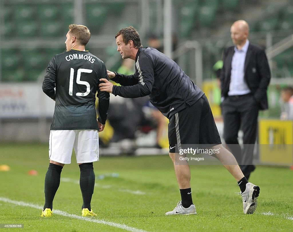 Ronny Deila head coach of Celtic gives the instructions to Cris Commons during the third qualifying round UEFA Champions League match between Legia and Celtic at Pepsi Arena on July 30, 2014 in Warsaw, Poland.