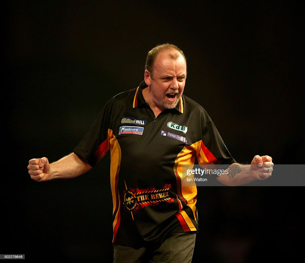 Ronny Huybrechts of Belgium celebrates during his match against Dean Winstanley of England during the 2016 William Hill PDC World Darts Championships...
