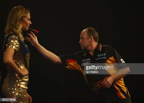 Ronny Huybrechts of Belgium in action during his match against Dean Winstanley during the 2016 William Hill PDC World Darts Championships on Day Five...