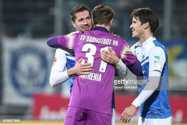 Ronny Koenig Dominik StrohEngel and goalkeeper Christian Mathenia of Darmstadt celebrate at the final whistle during the Second Bundesliga match...