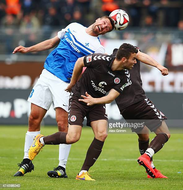 Ronny Koenig of Darmstadt is challenged by Dennis Daube of St Pauli during the Second Bundesliga match between SV Darmstadt 98 and FC St Pauli at...