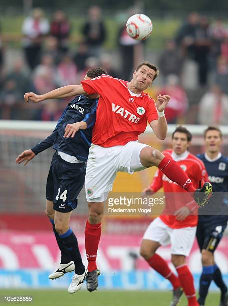 Ronny Koenig of Oberhausen and Florin Lovin of 1860 battle for the ball during the Second Bundesliga match between RW Oberhausen and 1860 Muenchen at...