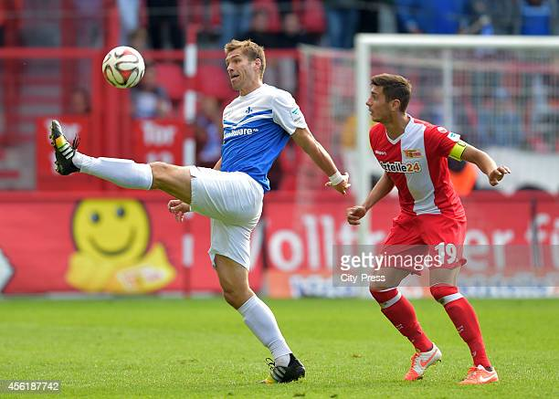 Ronny Koenig of SV Darmstadt 98 and Damir Kreilach of 1 FC Union Berlin in action during the game between 1 FC Union Berlin and SV Darmstadt 98 on...