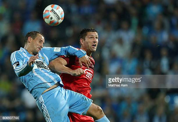 Ronny Koenig of Zwickau and Anton Fink of Chemnitz jump for a header during the third league match between Chemnitzer FC and FSV Zwickau at Stadion...
