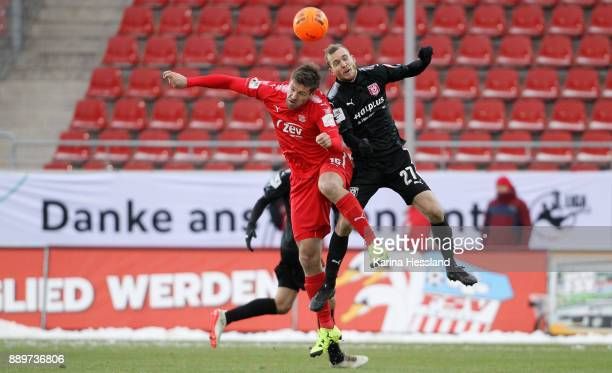 Ronny Koenig of Zwickau and Fabian Baumgaertel of Halle jump for a header in front of the Banner Danke ans Ehrenamt during the 3Liga match between...