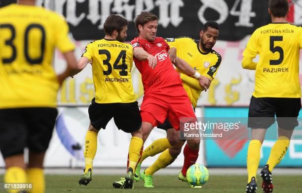 Ronny Koenig of Zwickau challenges Kristoffer Andersen and Bone Uaferro of Koeln during the Third League match between FSV Zwickau and Fortuna Koeln...