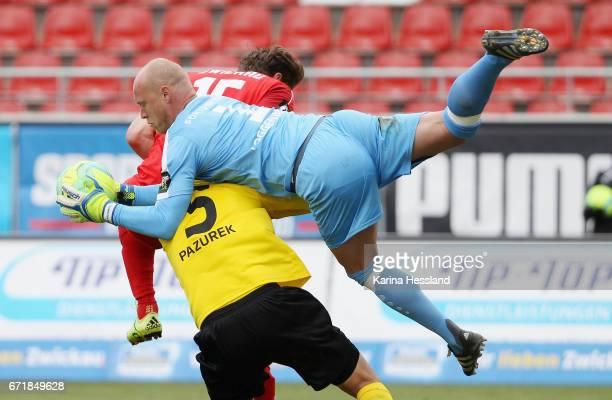 Ronny Koenig of Zwickau challenges Markus Pazurek and Goalkeeper Andre Poggenborg of Koeln during the Third League match between FSV Zwickau and...