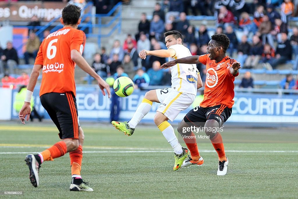 Ronny Lopes of Lille and Lamine Gassama of Lorient during the French Ligue 1 match between Fc Lorient and Lille OSC at Stade du Moustoir on April 30, 2016 in Lorient, France.
