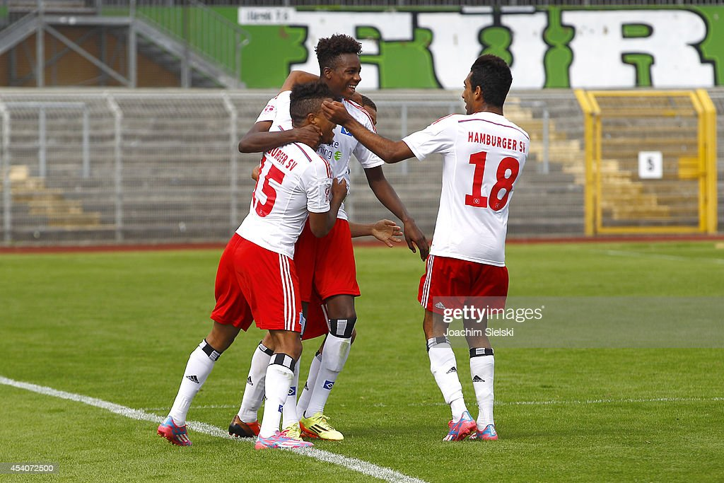 Ronny Marcos, Goalgetter Gideon Jung and Mohamed Gouaida of Hamburg celebrate after the goal 1:0 for Hamburg during the third league match between VfL Wolfsburg II and Hamburger SV II at VfL Stadion am Elsterweg on August 24, 2014 in Wolfsburg, Germany.