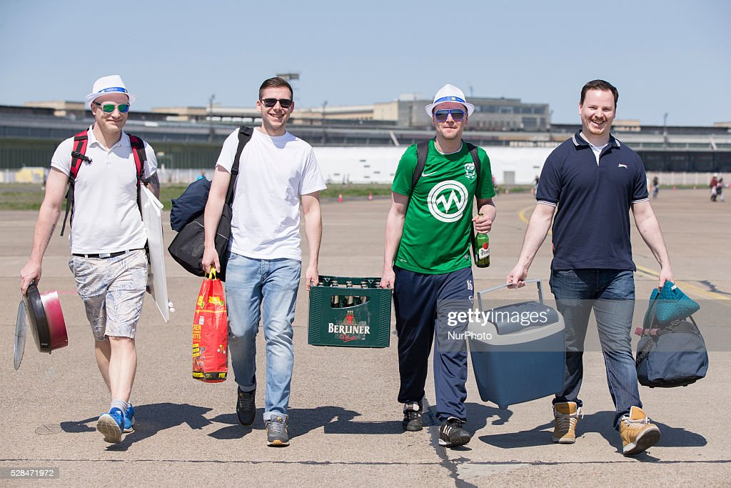 Ronny, Norman, Daniel and David from Berlin carry a box of beer of the label 'Berliner Pilsner' in the Tempelhofer Feld park during Father's Day or Man's Day in Berlin, Germany on May 5, 2016. In Germany is tradition for groups of males to do a hiking tour and use the holiday as occasion to get drunk.