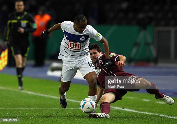 Ronny of Berlin and Florian Dick of Kaiserslautern battle for the ball during the DFB Cup round of sixteen match between Hertha BSC Berlin and 1 FC...