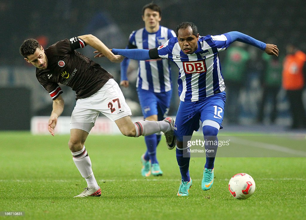 Ronny (R) of Berlin battles for the ball with Jan Philipp Kalla (L) of St. Pauli during the Second Bundesliga match between Hertha BSC Berlin and FC St. Pauli at Olympic stadium on November 19, 2012 in Berlin, Germany.
