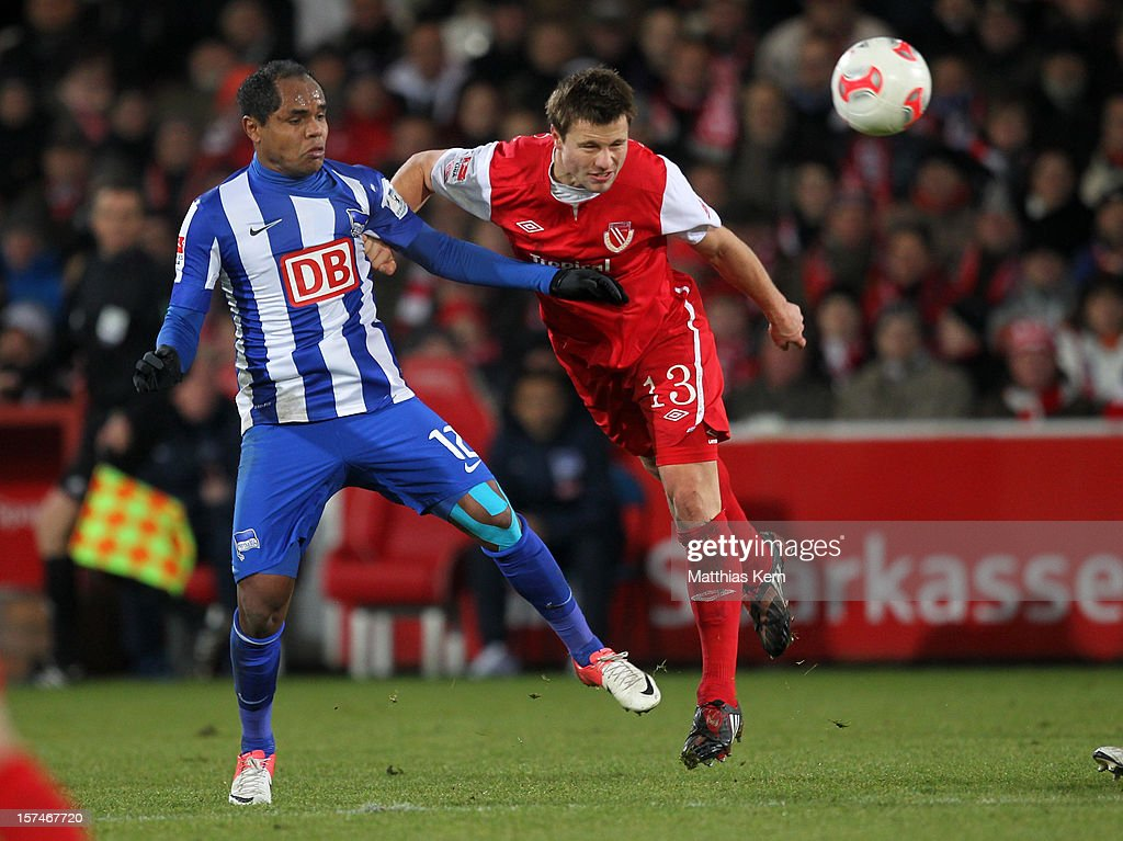 Ronny (L) of Berlin battles for the ball with Julian Boerner (R) of Cottbus during the Second Bundesliga match between FC Energie Cottbus and Hertha BSC Berlin at Stadion der Freundschaft on December 3, 2012 in Cottbus, Germany.