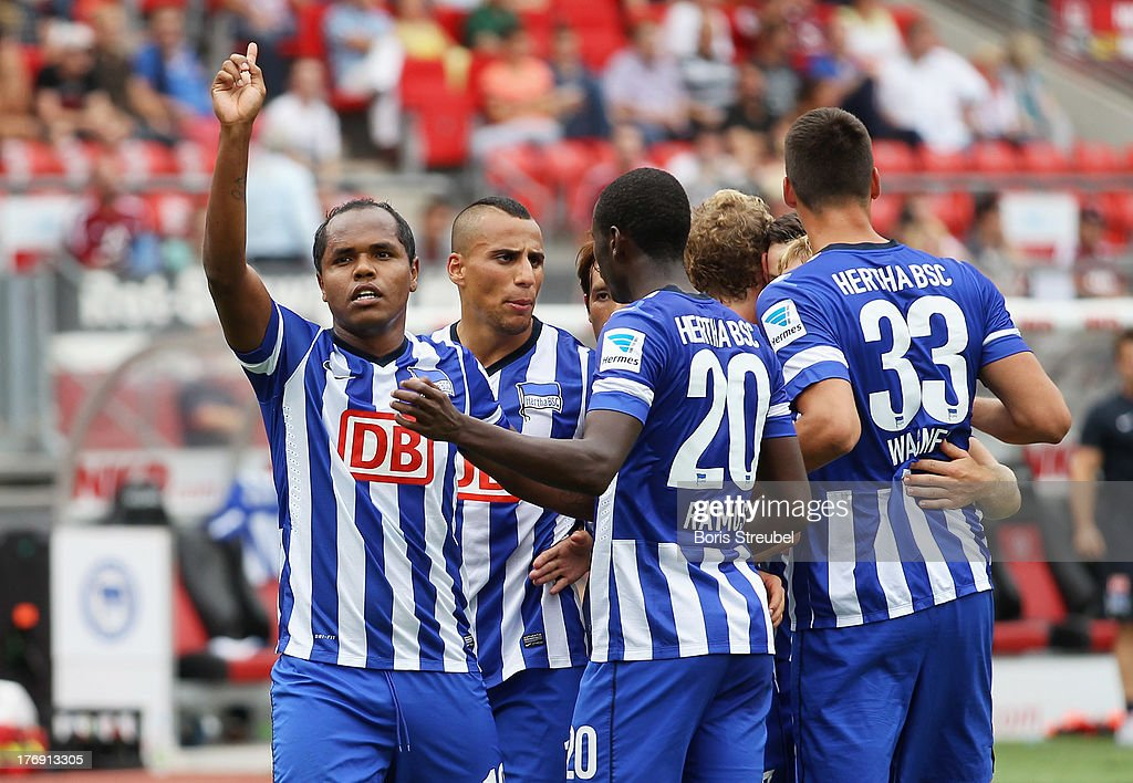 Ronny (L) of Berlin celebrates his team's second goal with team mates during the Bundesliga match between 1. FC Nuernberg and Hertha BSC Berlin at Grundig Stadium on August 18, 2013 in Nuremberg, Germany.