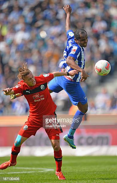 Ronny of Berlin challenges for the ball with Julian Schauerte of Sandhausen during the second Bundesliga match between Hertha Berlin SC and SV...