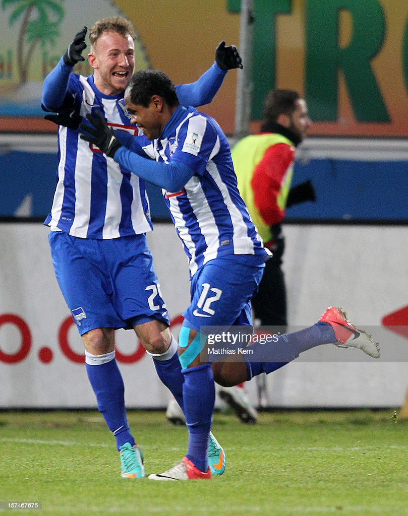 Ronny (R) of Berlin jubilates with team mate Marvin Knoll (L) after scoring the third goal during the Second Bundesliga match between FC Energie Cottbus and Hertha BSC Berlin at Stadion der Freundschaft on December 3, 2012 in Cottbus, Germany.