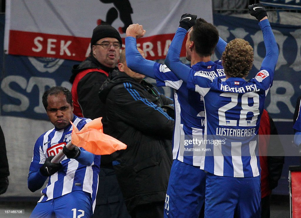 Ronny (L) of Berlin jubilates with team mates after scoring the third goal during the Second Bundesliga match between FC Energie Cottbus and Hertha BSC Berlin at Stadion der Freundschaft on December 3, 2012 in Cottbus, Germany.