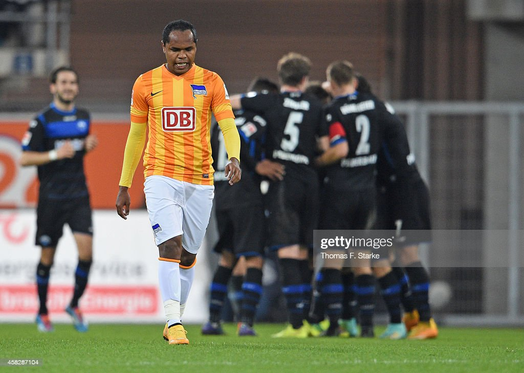 Ronny of Berlin looks dejected while players of Paderborn celebrate in the background during the Bundesliga match between SC Paderborn and Hertha BSC...