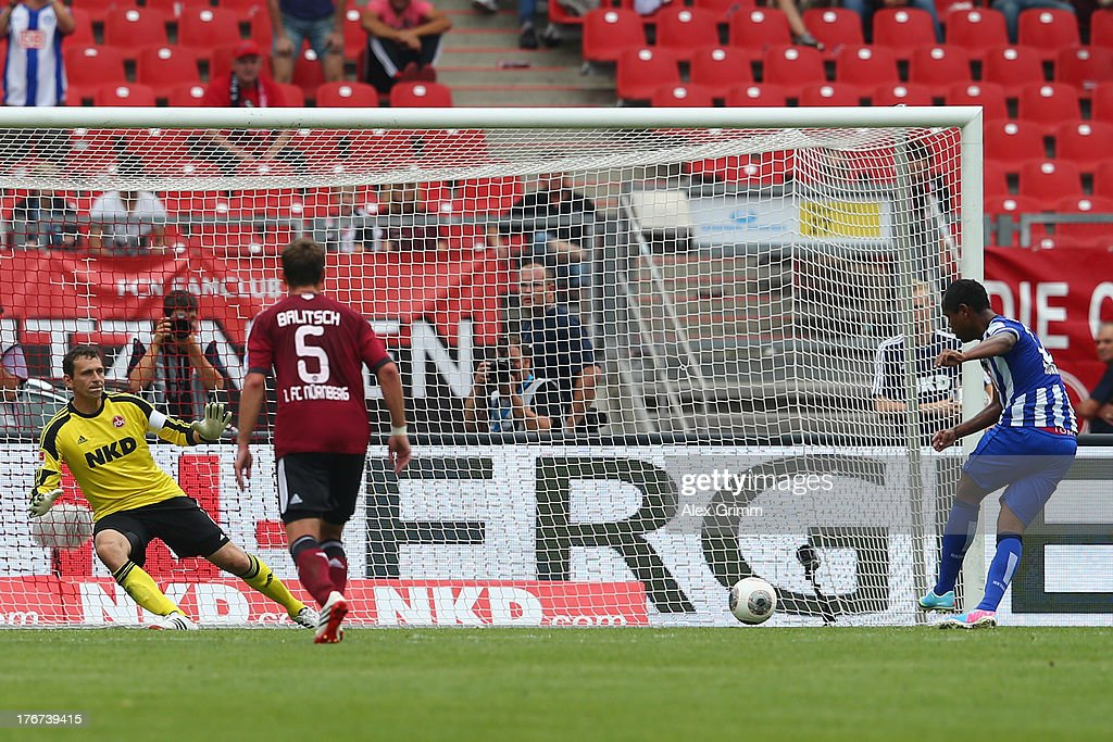 Ronny of Berlin scores his team's second goal with a penalty against goalkeeper <a gi-track='captionPersonalityLinkClicked' href=/galleries/search?phrase=Raphael+Schaefer&family=editorial&specificpeople=676328 ng-click='$event.stopPropagation()'>Raphael Schaefer</a> of Nuernberg during the Bundesliga match between 1. FC Nuernberg and Hertha BSC Berlin at Grundig Stadium on August 18, 2013 in Nuremberg, Germany.