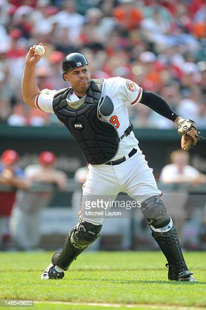 Ronny Paulino of the Baltimore Orioles fields a bunt during an interleague baseball game against the Philadelphia Phillies on June 10 2012 at Oriole...