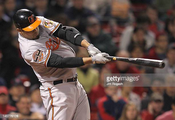 Ronny Paulino of the Baltimore Orioles knocks in the seventh and winning run in the ninth inning against the Boston Red Sox at Fenway Park June 5...