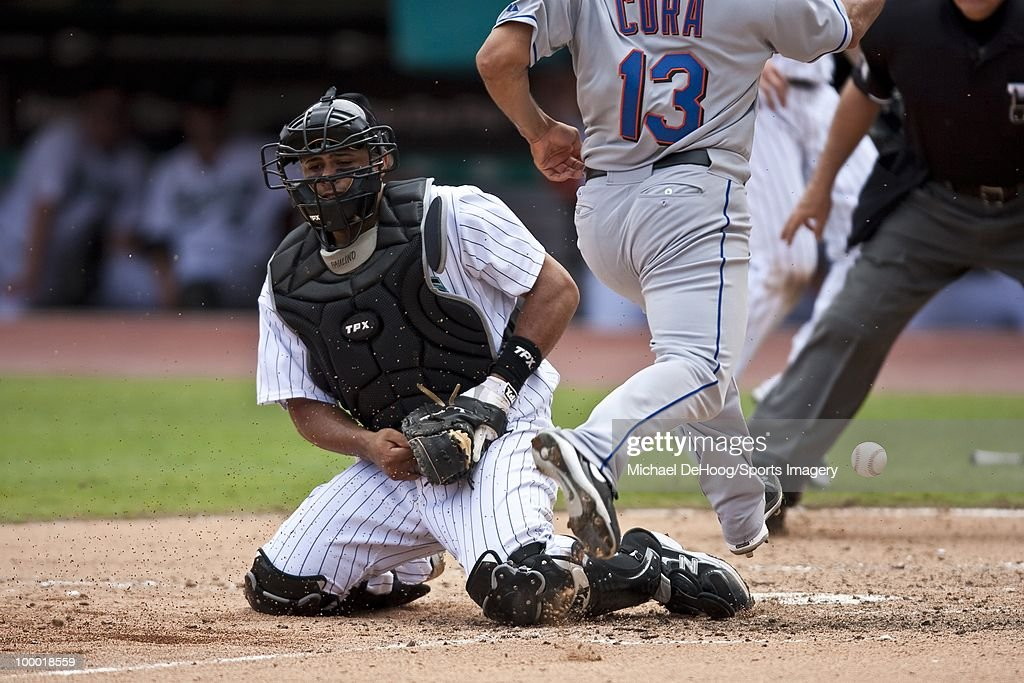 Ronny Paulino #29 of the Florida Marlins misses the throw to home during a MLB game against the New York Mets in Sun Life Stadium on May 16, 2010 in Miami, Florida.