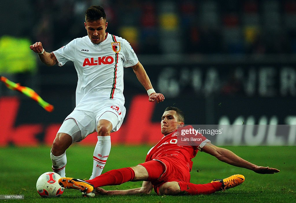 Ronny Philip of Augsburg is challenged by Oliver Fink of Duesseldorf during the Bundesliga match between Fortuna Duesseldorf 1895 and FC Augsburg at Esprit-Arena on January 20, 2013 in Duesseldorf, Germany.