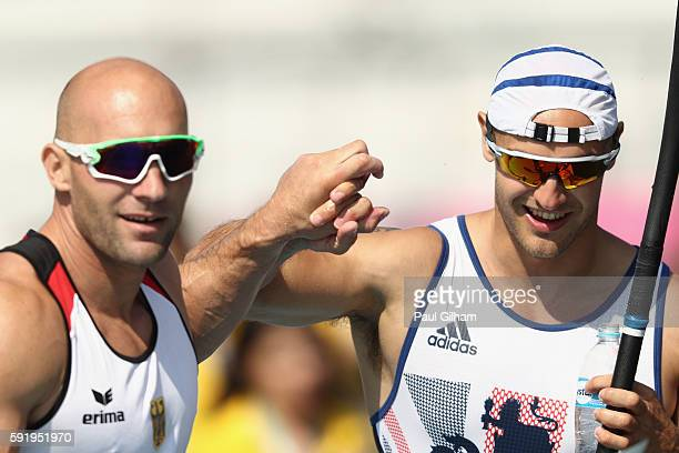 Ronny Rauhe of Germany and Liam Heath of Great Britain react after finishing in the Men's Kayak Single 200m on Day 14 of the Rio 2016 Olympic Games...