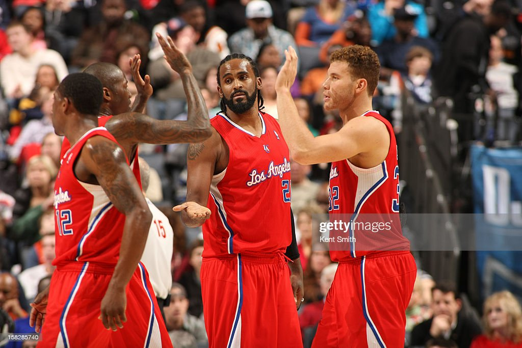 Ronny Turiaf #21 and Blake Griffin #32 of the Los Angeles Clippers celebrate with teammates during the game against the Charlotte Bobcats at the Time Warner Cable Arena on December 12, 2012 in Charlotte, North Carolina.