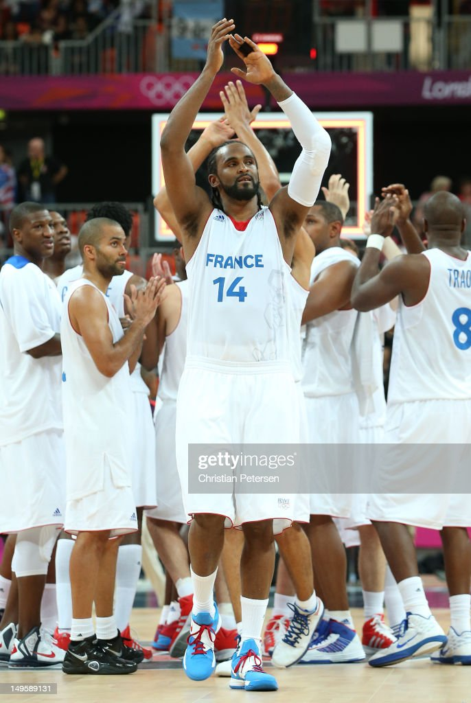 Ronny Turiaf #14 of France and team mates celebrate winning the Men's Basketball Preliminary Round match between France and Argentina on Day 4 of the London 2012 Olympic Games at Basketball Arena on July 31, 2012 in London, England.
